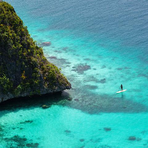 Paddling Between Wayag Karst Islands